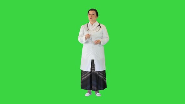 Mature Female Doctor Talking on Camera on a Green Screen Chroma Key