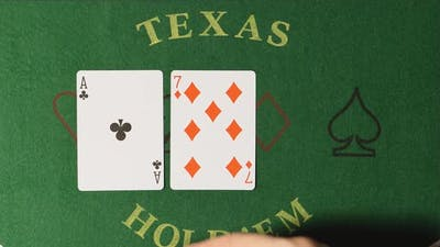 Poker - Dealer hands out cards on a green table