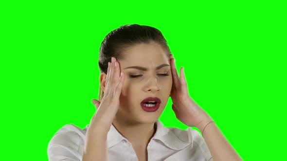 Thumbnail for Businesswoman Has Headache. Green Screen