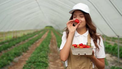 Beautiful Woman Sniffing and Admiring Strawberry