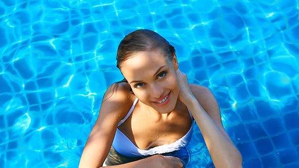 Thumbnail for Happy Young Woman Relaxing in Swimming Pool