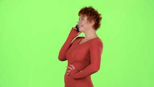 Woman Is Talking on the Phone and Smiling. Green Screen