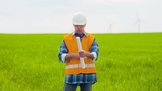 Thumbnail for Male Engineer Working While Holding Blueprint