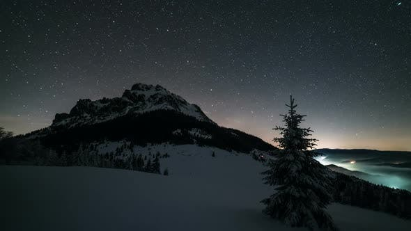 Thumbnail for Night Sky with Stars Moving over Mountain Peak in Winter Astronomy