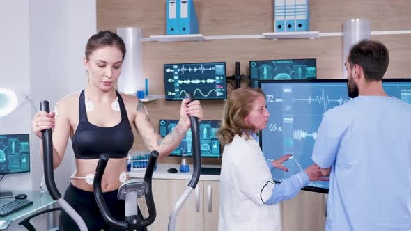 Thumbnail for Female Doctor in Sport Science Checking the Energy of Female Athlete on Tv Monitor