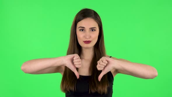Thumbnail for Unhappy Girl Showing Thumbs Down Gesture