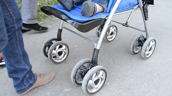 Thumbnail for Woman Pushing Baby Stroller