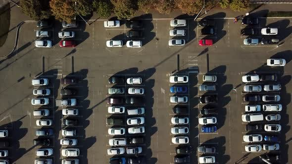 Aerial View of Parking with Parked Cars