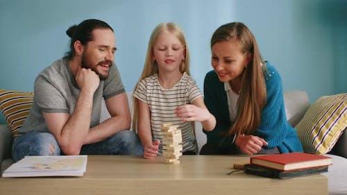 Joyful Family Plays Jenga