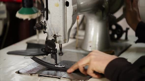 Thumbnail for Old Master Is Making Stitches By Vintage Industrial Sewing Machine on a Belt