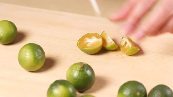 Thumbnail for Cutting Citrus on wooden cutting pad