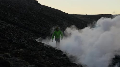 Man Emerging From Smoke Of Lava Flow From Erupting Fagradalsfjall Volcano