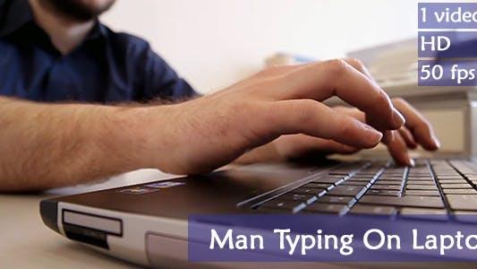Thumbnail for Man Typing On Laptop