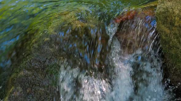 Thumbnail for the Water Flows Down the Rocks
