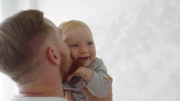 Cute Baby Spending Time with Father