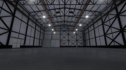 Empty Factory Hangar and Worker