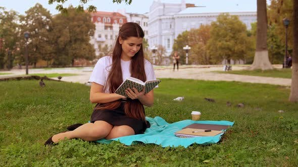 Thumbnail for Attractive Girl Studying Outdoors