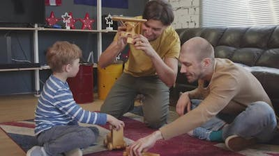 Fathers and Boy Playing with Toys