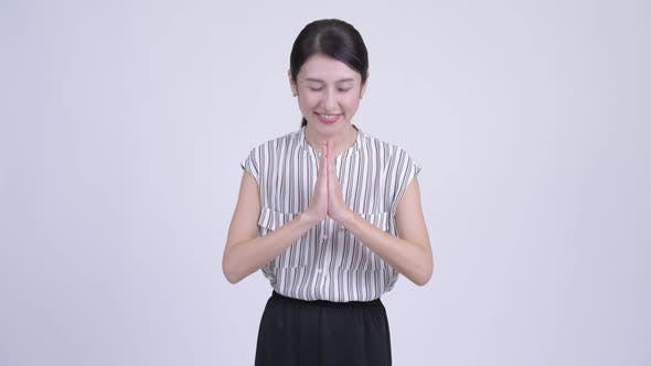 Thumbnail for Happy Beautiful Asian Businesswoman Greeting with Respect