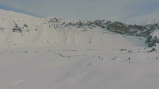 Cover Image for Aerial Flight Over Winter Mountains Snow Ridge
