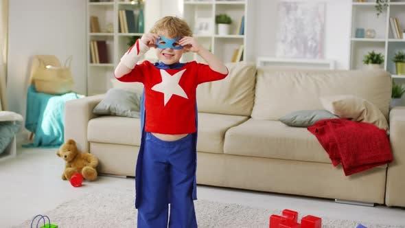 Thumbnail for Small Boy Dressing Superhero Eye Mask
