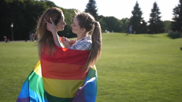 Thumbnail for Young Gay Couple Standing Wrapped in Lgbt Flag