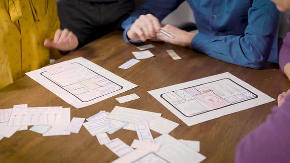 Thumbnail for Technical Specialists Are Developing and Discussing New Algorithms, Viewing Scheme on Paper
