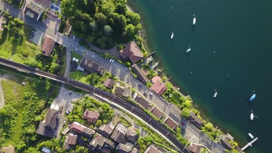 Thumbnail for Aerial drone view of a town with train tracks near Lake Maggiore, Switzerland.