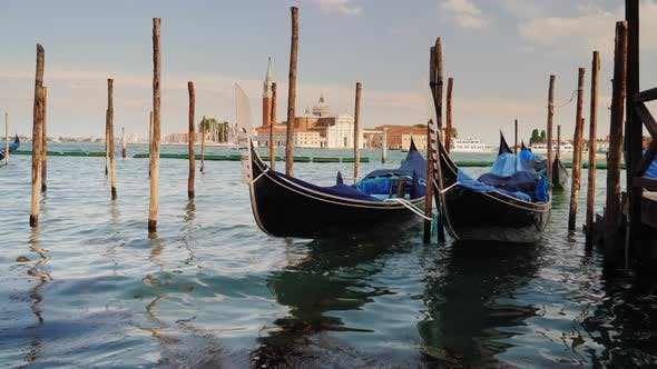 Thumbnail for Several Gondolas Rock on the Sea Waves Off the Coast. The Symbol of Venice and
