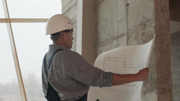 Construction Specialist Holding Building Plan