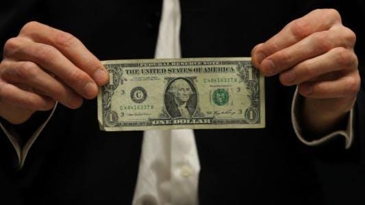 Thumbnail for Businessman Rumpling Dollar