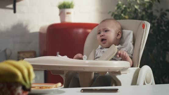 Thumbnail for Baby Crying in High Chair