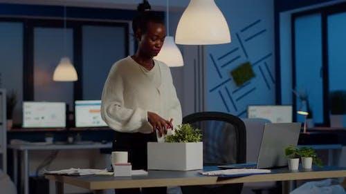 Upset Dismissed Black Woman Employee Putting Stuff in Box