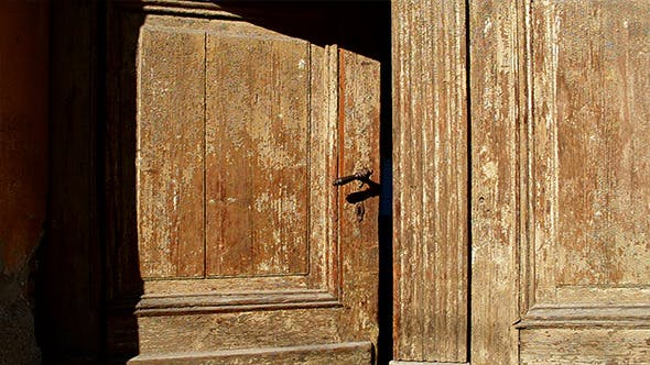 Cover Image for Old Wooden Door is Closing