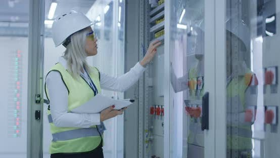 Thumbnail for Woman with Tablet Monitoring Electrical Engineering