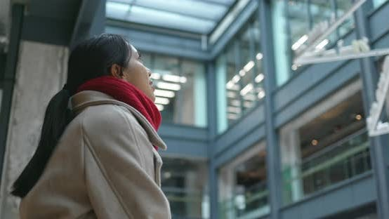 Thumbnail for Woman look far away inside the business building