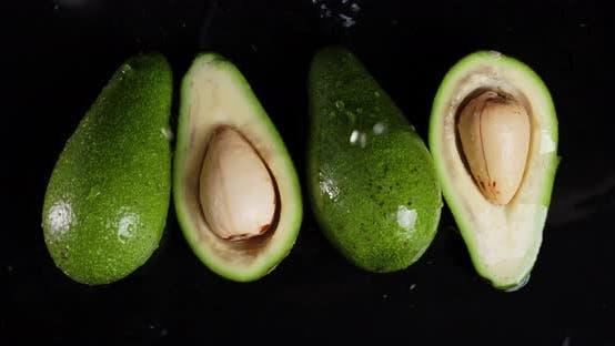 Rain Drops Falling on Fresh Avocado