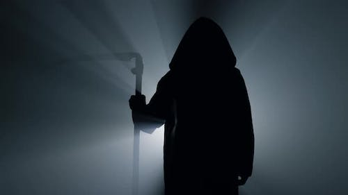 Silhouette Grim Reaper Waiting with Scythe Indoors