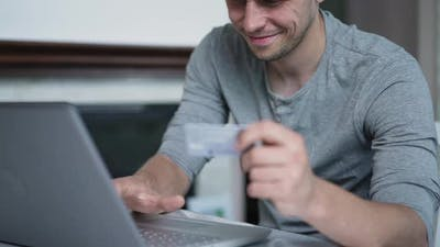 Man Uses Credit Card to Buy Online