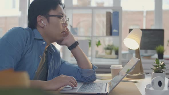 Thumbnail for Lazy Asian Office Worker Sleeping at Desk