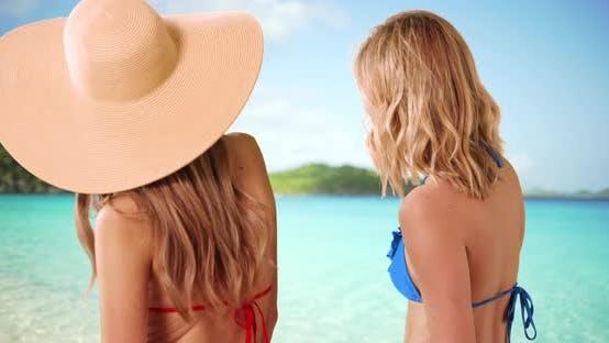 Thumbnail for Close view of cute bikini girls standing on tropical beach enjoying ocean view