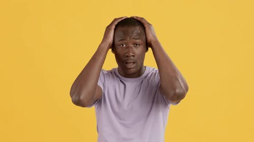 Emotional African American Guy Touching His Head in Panic