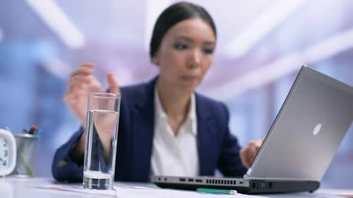 Busy Female Employee Drinking Water From Glass Sitting Office Table, Refreshment