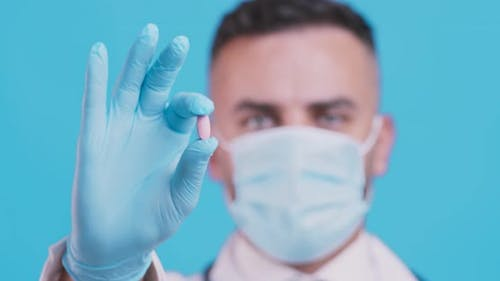 Treatment Recommendation, Doctor Showing Medical Pill, Wearing Protective Mask and Gloves