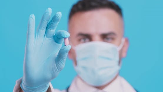 Thumbnail for Treatment Recommendation, Doctor Showing Medical Pill, Wearing Protective Mask and Gloves