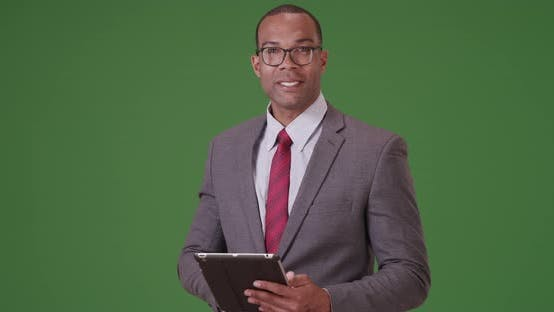 Thumbnail for A black business professional poses for a portrait  on green screen