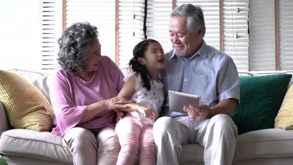 couple senior and child at home