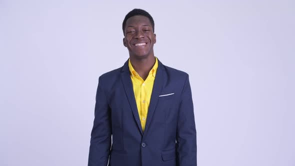 Young Happy African Businessman in Suit Smiling