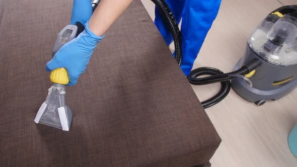 Thumbnail for Cleanliness Concept. Dry Cleaning Worker Removing Dirt From Upholstered Furniture
