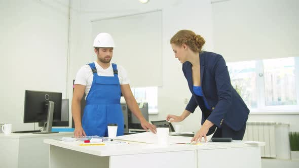 Builder and Engineer in the Office, Woman Draw on Whatman Paper with Pencil and Ruler